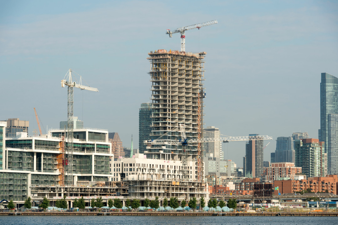 A view of cranes and buildings being built along the waterfront in Toronto.
